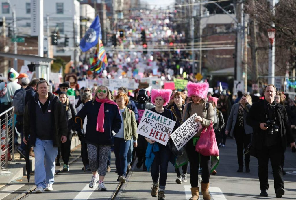 "People march down South Jackson Street during the Women's March in Seattle, Washington on January 21, 2017. Led by women in pink ""pussyhats,"" hundreds of thousands of people packed the streets of Washington and other cities Saturday in a massive outpouring of defiant opposition to America's hardline new president, Donald Trump. / AFP PHOTO / Jason RedmondJASON REDMOND/AFP/Getty Images NYTCREDIT: Jason Redmond/Agence France-Presse -- Getty Images"